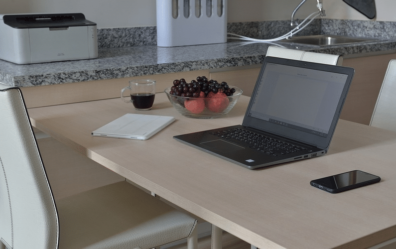 laptop on kitchen table | jobs from home | Peace Evolution