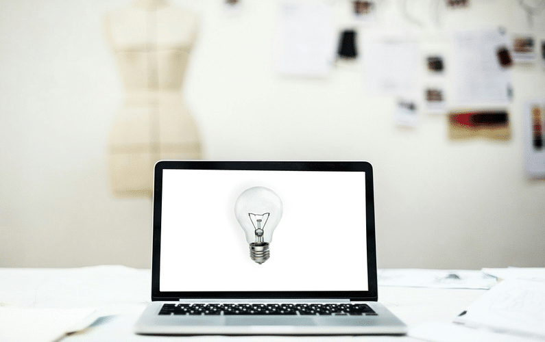 screen with lightbulb indicating ideas | small business | Peace Evolution