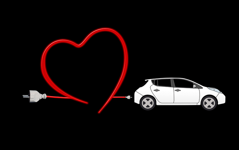 recharging electric car with red cord in heart shape | electric cars | Peace Evolution