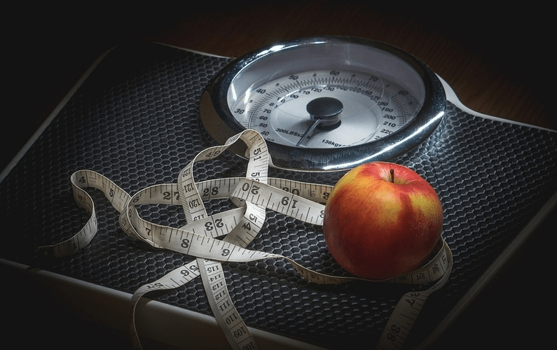 scale with tapemeasure and apple | autophagy healing | Peace Evolution