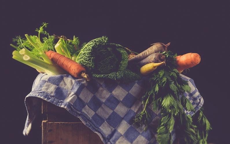 vintage look table of veggies | aspartame dangers | Peace Evolution