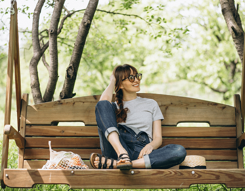 woman relaxing on a bench | eco friendly | Peace Evolution